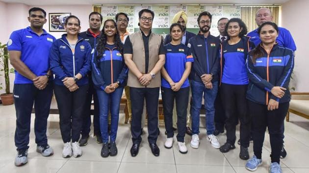 Union Sports Minister Kiren Rijiju in a group photo with members of the Indian shooting team.(PTI)