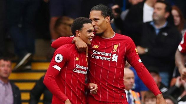 Liverpool's Trent Alexander-Arnold celebrates scoring their first goal with Virgil van Dijk.(REUTERS)