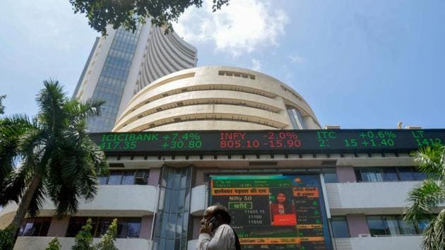 A screen at the facade of the Bombay Stock Exchange (BSE) building shows the stock prices.(PTI)