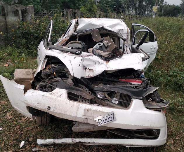Mangled remains of the car after the accident on Patiala-Samana road on Sunday night.(HT PHOTO)