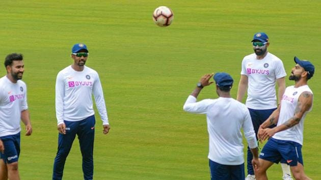 Indian skipper Virat Kohli (R) plays football with teammates during a practice session.(PTI)