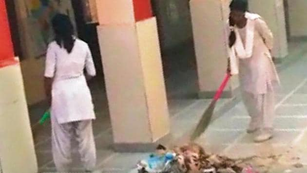 Videos of school girls sweeping the floor of the school premises, were shared multiple times on WhatsApp on Monday.(HT Photo)