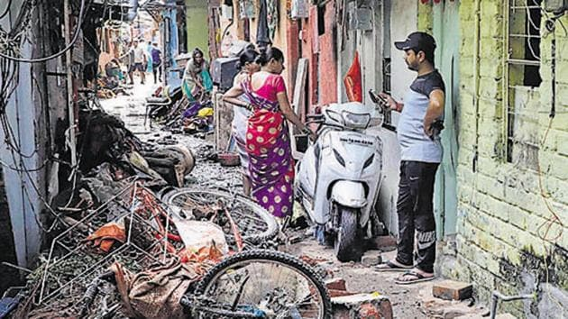 Residents of the Tangewala colony in Sahakarnagar, who were affected by the flash floods allege that they are not getting necessary help from the Pune Municipal Corporation.(HT/PHOTO)