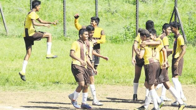 St Vincents' players celebrate after winning the penalty shoot-out at the ZP u-17 football finals at Dobarwadi ground on Monday.(Rahul Raut/HT PHOTO)