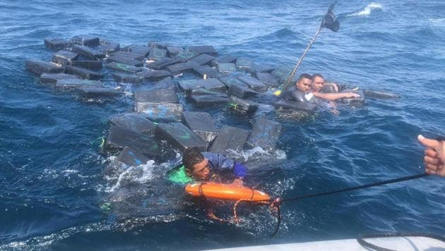 Three suspected drug smugglers survived in shark-infested Pacific waters by clinging for hours to floating bales of cocaine, Colombia's navy said Tuesday.(@ArmadaColombia/Twitter)