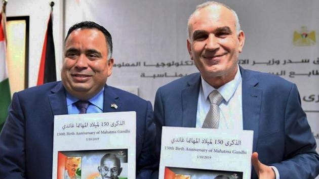 Representative of India (ROI) in Palestinian Authority Sunil Kumar and Palestinian Minister of Telecommunication and Information Technology, Dr. Ishaaq Seder release the commemorative stamp to honour Mahatma Gandhi on his 150th birth anniversary, in Ramallah, Israel.(PTI)