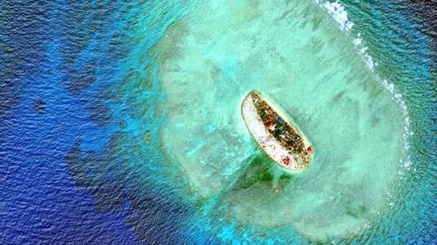Satellite images show Vietnam has carried out significant land reclamation at two sites in the disputed South China Sea, but the scale and pace of the work is dwarfed by that of China, a US research institute said.(Reuters File Photo)