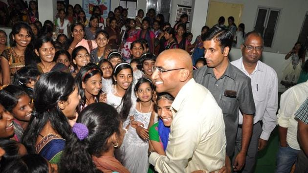 Telangana Social Welfare Residential Educational Institutions secretary R S Praveen Kumar, IPS, with his students.(HT Photo)