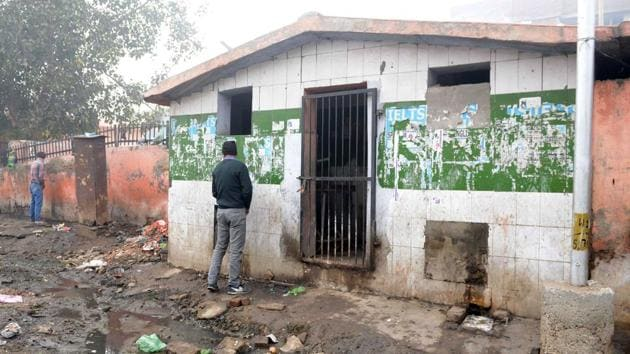 """Men urinate outside of a locked public toilet on a street in Amritsar, Punjab. """"Latrine ownership increased from about 35 percent to about 70 percent... That did accelerate the reduction of open defecation,"""" said Sangita Vyas from the Research Institute for Compassionate Economics (RICE). """"But in December 2018 we estimated about half of people in the states of Bihar, Madhya Pradesh, Uttar Pradesh and Rajasthan still defecated in the open,"""" she said. (Narinder Nahu / AFP)"""