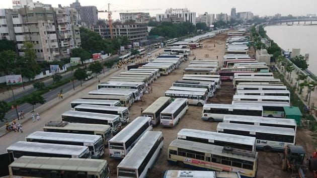 Buses of village heads are seen parked outside the venue of Prime Minister Narendra Modi's function. The PM made the declaration by pressing the button of a remote, unveiling the map of India as ODF. Simultaneously, the website of the Swachh Bharat Mission- Gramin, which caters to rural India, reported toilet cover to be 100%. (Sam Panthaky / AFP)