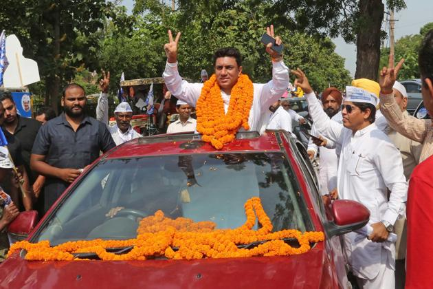 AAP candidate Yogeswar Sharma during a roadshow before filing nomination papers in Panchkula on Thursday.