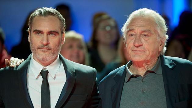 Actors Joaquin Phoenix (L) and Robert De Niro (R) attend the Joker premiere during the 2019 Toronto International Film Festival.(AFP)
