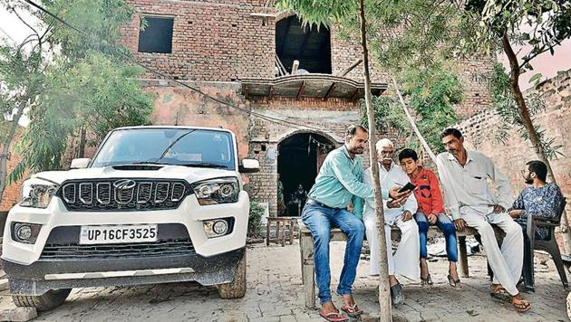 In Ranhera village, Balbhadr Singh, 85, has got Rs 24 crore as compensation. He is rebuilding his house and has purchased a new SUV.(Biplov Bhuyan/HT PHOTO)