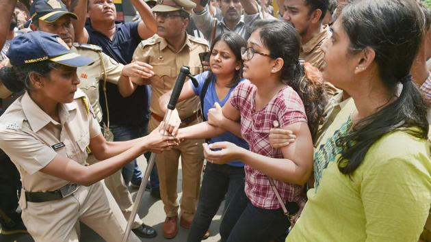 Police detain activists who were staging a protest against the tree-cutting, being carried out for the Metro car shed project, at Aarey colony in Mumbai, Saturday, Oct. 5, 2019.(PTI)