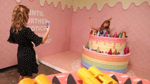 """A girl poses for a photo during a visit to the Instagram museum """"Smile Safari"""" that recently opened in Brussels. (REUTERS)"""