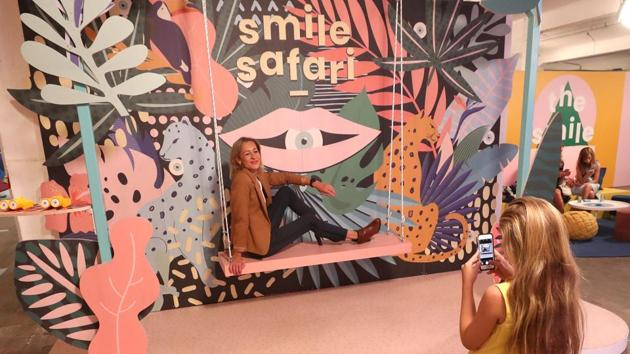 """A woman poses for a photo during a visit to the Instagram museum """"Smile Safari"""". (REUTERS)"""