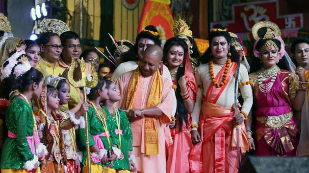 Uttar Pradesh Chief Minister Yogi Adityanath felicitates artists during the Dussehra celebration at Aishbagh Ram Leela ground in Lucknow on Friday(ANI Photo)