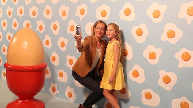 """Visitors take photos at the Instagram museum """"Smile Safari"""" that recently opened in Brussels. (REUTERS)"""