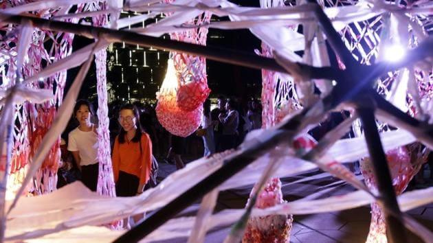 Two women look at the work of Taiwanese artists Peng yu-hong and Yang Fang-Yi. (AP)