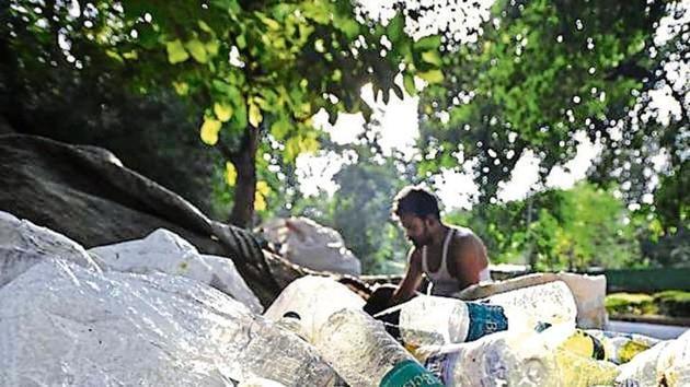 A scrap vendor sorts plastic bottles in New Delhi.(File Photo)