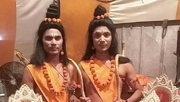 Anuj Pandey (left, standing) with other characters of Ramlila being organised in Rajguru Nagar on Monday.(HT PHOTO)