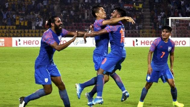 Indian football captain Sunil Chhetri celebrates with team mates after scoring a goal against Oman in FIFA World Cup' qualifiers.(PTI)