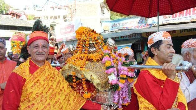 Priests taking the palanquin of Lord Raghunath to his temporary abode at Dhalpur as week-long Dussehra festivities kicked off in Kullu on Tuesday.(Aqil Khan)