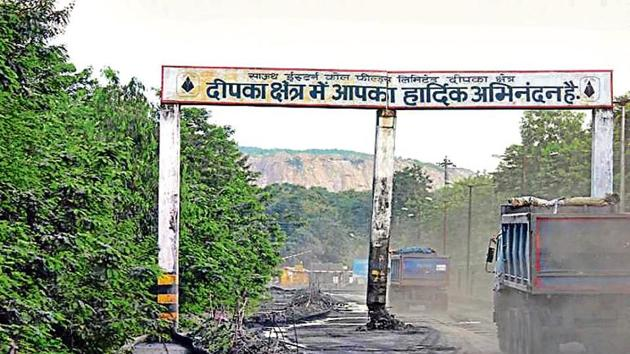 Trucks at the entry point into Dipka town.(HT PHOTO)
