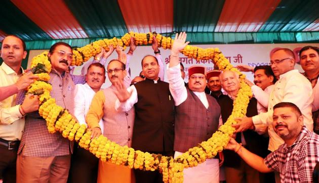 BJP national working president JP Nadda, Himachal Pradesh chief minister Jai Ram Thakur and other leaders during a rally in Mandi on Wednesday.(Birbal Sharma/HT)