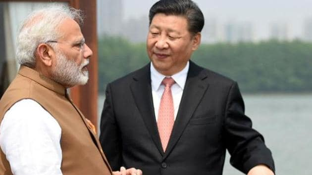 Prime Minister Narendra Modi with China's President Mr. Xi Jinping inside a house boat in Wuhan's East Lake, China on April 28, 2018.(File photo)