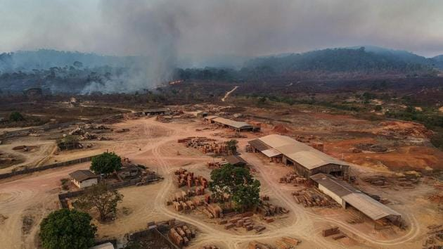 A view of a sawmill in Moraes Almeida town, along a section of the trans Amazonian highyway, in Itaituba. Travel times are worse during the wet season from November to June, when sections of the highways turn into thick mud, or when hundreds of wildcat miners block a highway for days to demand legal status, like they did recently in Moraes Almeida, which straddles the BR163. (Nelson Almeida / AFP)