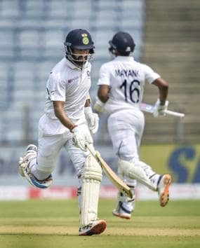 Pune: Indian cricket team players Cheteshwar Pujara and Mayank Agarwal run between the wickets during the second India-South Africa cricket test match at Maharashtra Cricket Association Stadium, in Pune. (PTI)