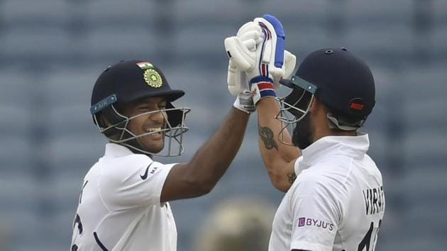 Pune: Indian cricket team player Mayank Agarwal celebrates his century with captain Virat Kohli during the second India-South Africa cricket test match at Maharashtra Cricket Association Stadium in Pune. (PTI)