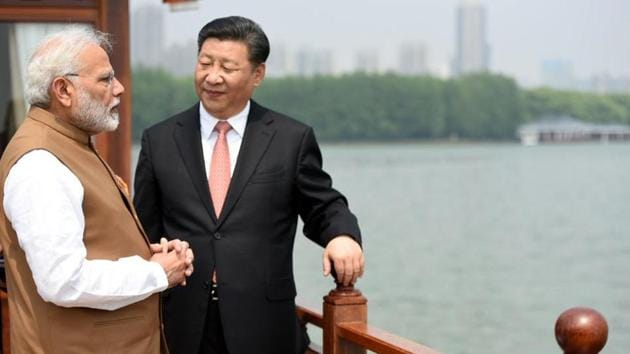 Prime Minister Narendra Modi and the President of the People's Republic of China, Mr. Xi Jinping inside a house boat, in Wuhan's East Lake, China in 2018.