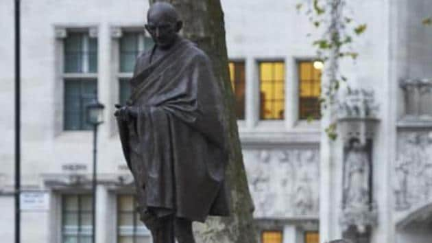A statue of Mahatma Gandhi, in Parliament Square, London. Britain has decided to mint coin with images of Mahatma Gandhi.(AP File)