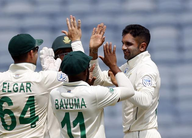 South Africa's cricketer Keshav Maharaj, right, celebrates after dismissing India's Ajinkya Rahane during the second day of the second cricket test match between India and South Africa in Pune. (AP)