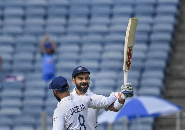 Pune: Indian cricket team Captain Virat Kohli acknowledges the crowd after scoring double century on day 2 of second India-South Africa cricket test match, at Maharashtra Cricket Association Stadium in Pune. (PTI)