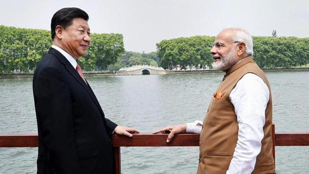 Prime Minister Narendra Modi with Chinese President Xi Jinping along the East Lake, in Wuhan, China.(PTI Photo)