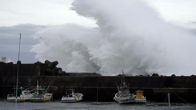 Surging waves hit against the breakwater while Typhoon Hagibis approaches at a port in town of Kiho, Mie.(AP)