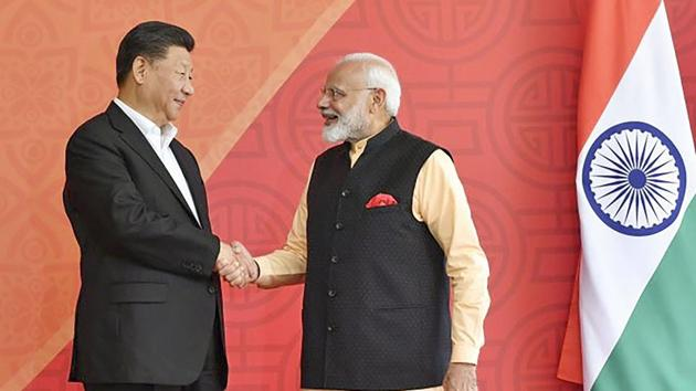 Prime Minister Narendra Modi with Chinese President Xi Jinping, at Fisherman's Cove in Kovalam near Mamallapuram .(PTI photo)