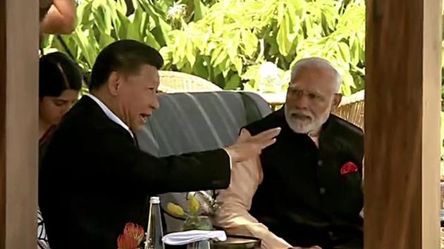 Prime Minister Narendra Modi and Chinese President Xi Jinping at Taj Fisherman's Cove hotel, in Kovalam on Saturday. (ANI Photo)
