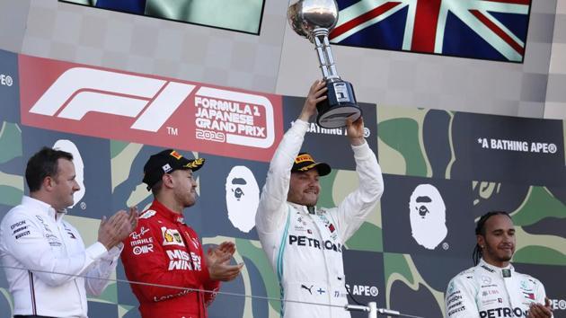 Mercedes' Valtteri Bottas celebrates winning the race.(REUTERS)