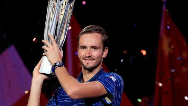 Daniil Medvedev of Russia celebrates winning Shanghai Masters with his trophy.(REUTERS)