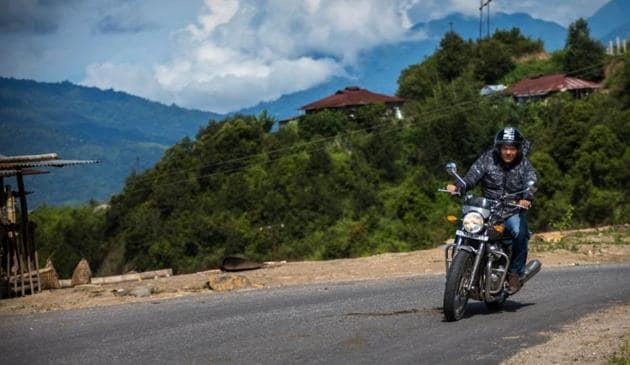 Arunachal Pradesh Chief Minister Pema Khandu during his ride from Yingkiong, the headquarters of Upper Siang district, to Pasighat, the headquarters of East Siang district on Sunday.(HT PHOTO)