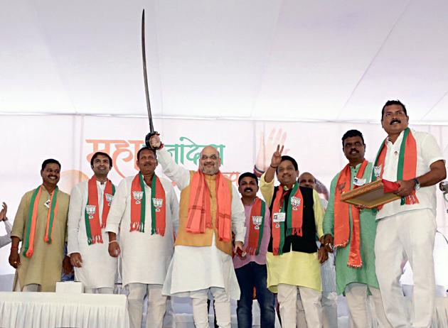 Union Home Minister Amit Shah holding the sword at an election rally in Maharashtra.(ANI Photo)