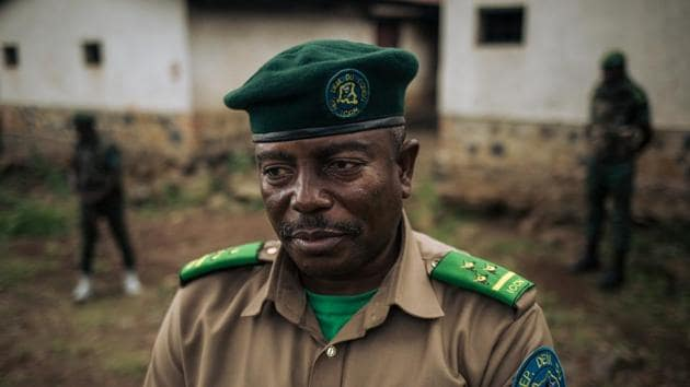 """De-Dieu Bya'Ombe Balongelwa, Chief of Kahuzi-Biega National Park, stands at courtyard of the park headquarters. """"There were armed men on the farms. These were purely military operations,"""" Balongelwa said. """"The farmers vowed to use every means to undermine us. Using the Pygmies to come and destroy the park is one of them,"""" said the director, who is given round-the-clock protection by two armed rangers. """"I've done what others didn't dare do."""" (Alexis Huguet / AFP)"""