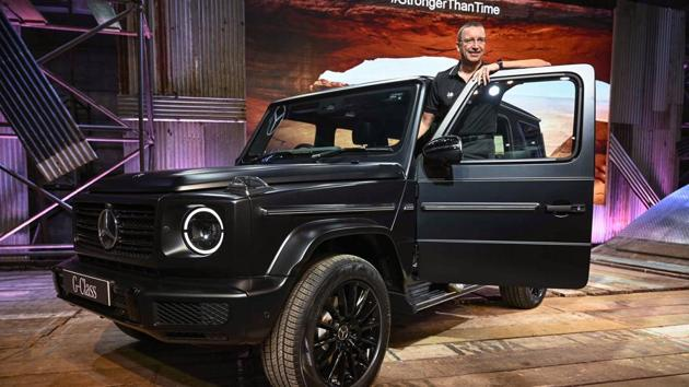 Mercedes-Benz MD and CEO Martin Schwenk poses with the newly unvelied Mercedes-Benz G350d in Mumbai.