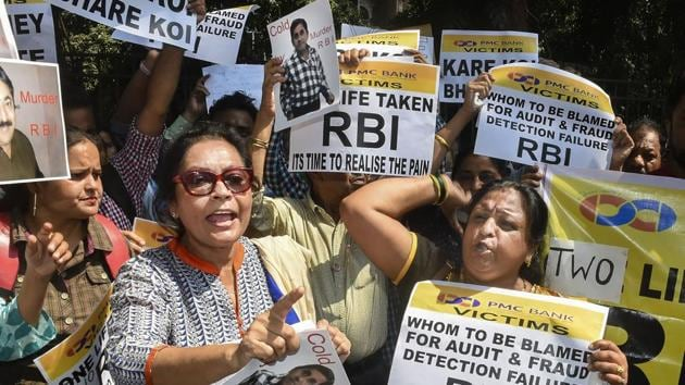 Depositors of the Punjab and Maharashtra Co-operative Bank (PMC) display placards during a protest over the Reserve Bank of India (RBI)'s curb on the bank, outside Esplanade court in Mumbai on Wednesday.(PTI Photo)