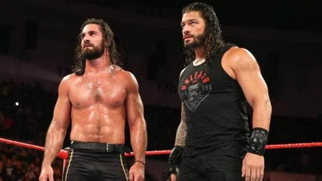 A file photo of Seth Rollins (L) and Roman Reigns.(Twitter)