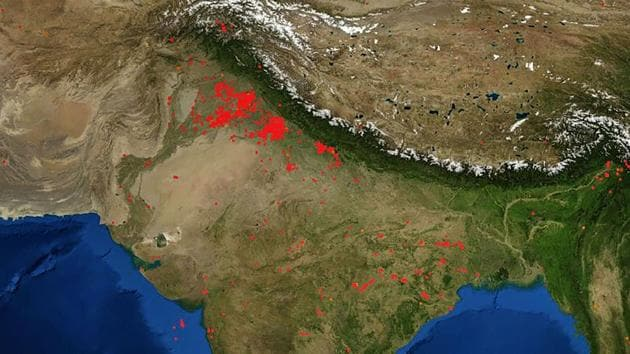Red dots indicate stubble burning in areas surrounding Delhi in this image released on October 15. NASA scientists reported fewer cases of farm fires in the region from September 25, when harvesting began in these states. Experts blame this dip in the capital's air quality mainly on local factors such as construction and road dust, and garbage burning that need to be reined in urgently. (NASA FIRMS / PTI)